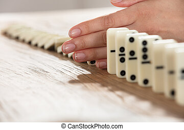 Businesswoman Supports Domino From Falling