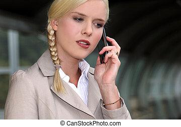 businesswoman taking the underground