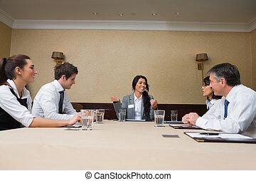 Businesswoman talking at meeting