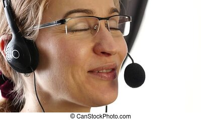 businesswoman talking on a headset in an office. customer...