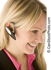 Businesswoman Talking On Hands Free Phone