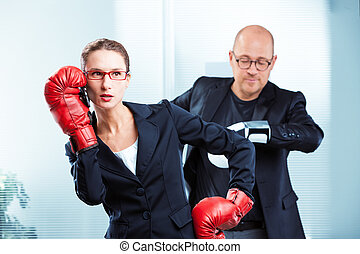Businesswoman talking on phone with boxing gloves