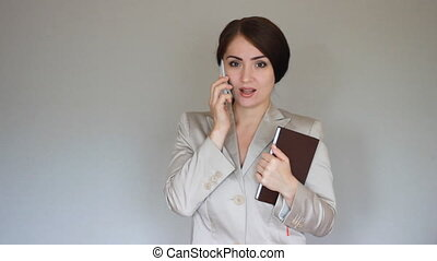 Businesswoman talking on the mobile phone. Business Negotiation. Success and victory