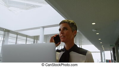 Businesswoman talking on the phone 4k - Businesswoman...