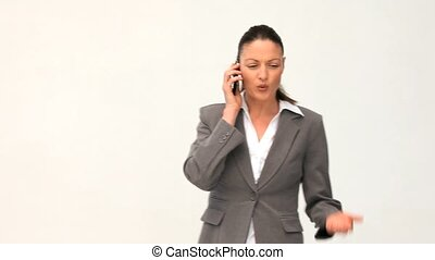 Businesswoman talking on the phone against a white...