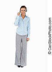 Businesswoman talking to caller through headset