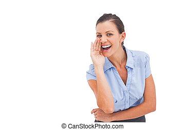 Businesswoman telling a secret hiding her mouth