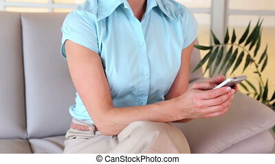 Businesswoman texting on the phone - Businesswoman texting...