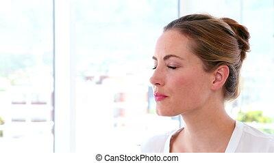 Businesswoman thinking at her desk