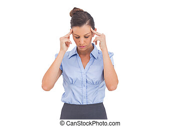 Businesswoman thinking with fingers on her temples