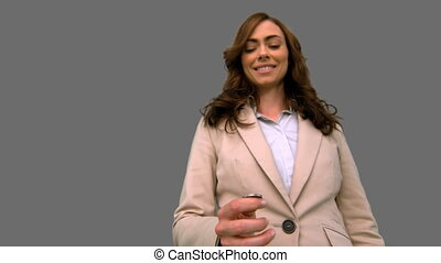 Businesswoman throwing a coin in the air