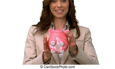 Businesswoman throwing a piggy bank on white screen in slow...