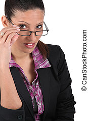 Businesswoman tipping glasses