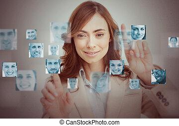 Businesswoman touching digital interface