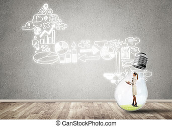 Businesswoman trapped in bulb - Businesswoman inside of...
