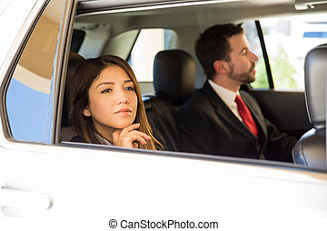Businesswoman traveling by car
