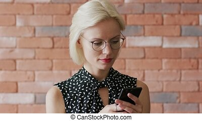 Businesswoman typing message on smartphone - Pretty young...