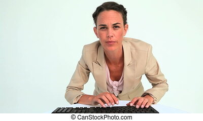 Businesswoman typing on a keyboard and on the camera