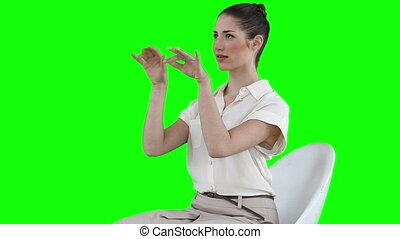 Businesswoman typing on a virtual keyboard