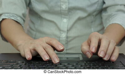 Businesswoman Typing on Laptop