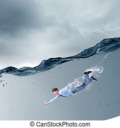 Businesswoman under water - Young businessman in suit...