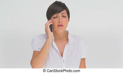 Businesswoman upset as she talks on a phone