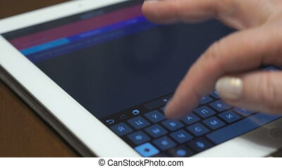 Businesswoman uses a digital tablet. Closeup.