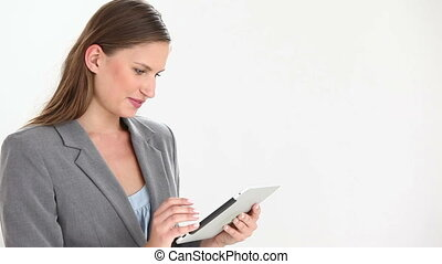 Businesswoman using a digital tablet against a white...