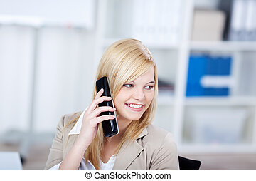 Businesswoman Using Cordless Phone While Looking Away