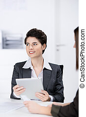 Businesswoman Using Digital Tablet In Meeting
