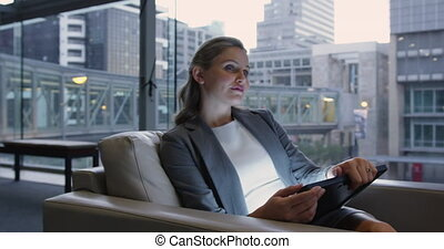 Businesswoman using digital tablet in the lobby at office 4k...