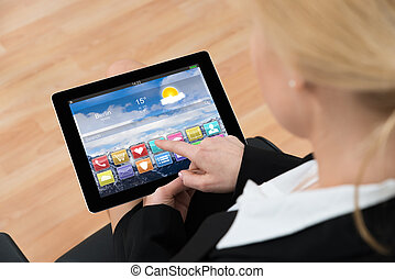 Businesswoman Using Digital Tablet With App