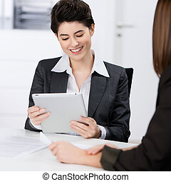 Businesswoman Using Digital Tablet With Coworker