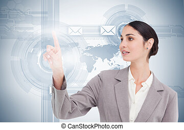 Businesswoman using futuristic interface with her fingertip