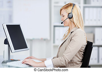 businesswoman using headset at business desk