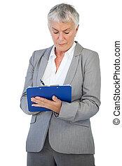 Businesswoman using her clipboard
