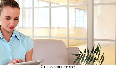 Businesswoman using her tablet on