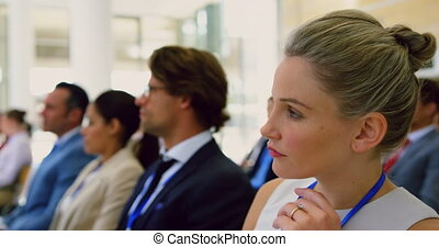 Businesswoman using laptop in a seminar 4k - Side view of ...