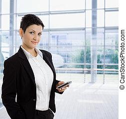 Businesswoman using mobile