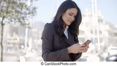 Businesswoman Using Phone On The Street
