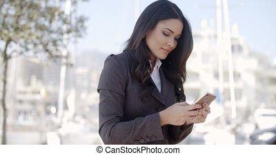 Businesswoman Using Phone On The Street