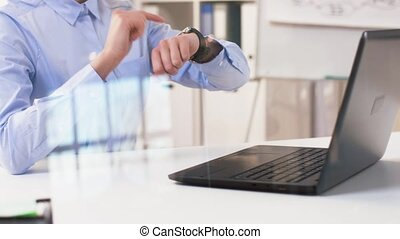 businesswoman using smart watch at office - business,...