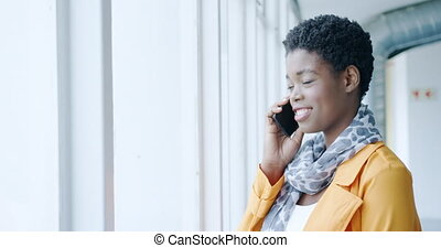 Businesswoman using smartphone - Side view close up of a ...