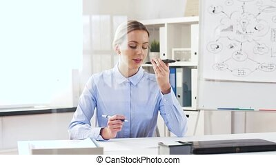 businesswoman using smartphone voice recorder - business,...