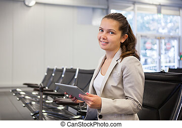 Businesswoman Using Tablet Computer At Airport Lobby