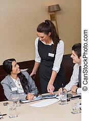 Businesswoman using tablet in meeting