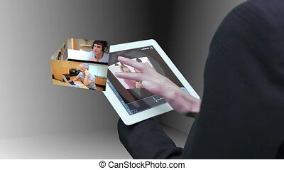 Businesswoman using tablet to view