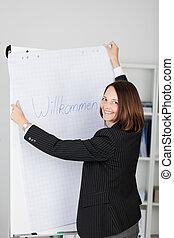 businesswoman, vasthouden, welkom teken, in, kantoor