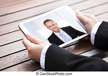 Businesswoman Video Conferencing With Colleague
