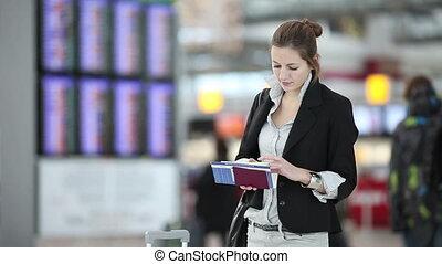Businesswoman waiting for flight